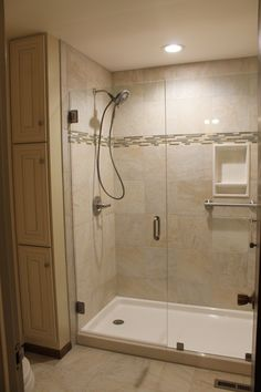 Updated shower and vanity room. Onyx shower base, tile from World of Tile, Delta fixtures, Custom glass doors by Evergreen Glass. Contractor Rusch Residential Construction