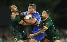 Canberra Raiders Josh Papali of Samoa is tackled during the 2017 Rugby League World Cup Quarter Final match between Australia and Samoa at Darwin Stadium on November 17, 2017 in Darwin, Australia.