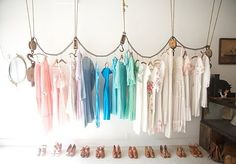 trendy store window display | love the idea of using rope and pullies as a clothes hanger,