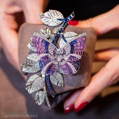 "Van Cleef  & Arpels ""Papillon Mystérieux"" Clip presented at Masterpiece London.  The Diamond branch can be removed to become a comb. Crafted in Sapphires of various shades and brilliant-, baguette- and square-cut Diamonds (the Centre stone is 2.29 cts marquise cut -D-IF."