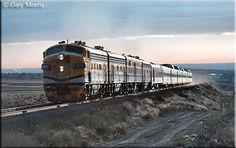 It is the Rio Grande Zephyr era as D two and a rare Alco PB lead the train westbound near Denver during a November evening in Train Car, Train Travel, Train Room, Railroad Industry, California Zephyr, Train Posters, Rail Transport, Train Engines, Electric Locomotive