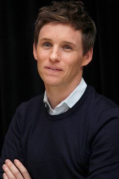 """Eddie Redmayne poses at a photocall for the movie """"The Danish Girl"""" on September 13, 2015"""