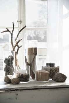 stones with sand in glass - great way to display my sand and rocks from vacation