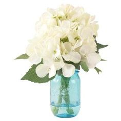 """Add a charming centerpiece to your desk or coffee table with this beautiful faux hydrangea arrangement, showcasing lush blooms nestled in a Mason jar.  Product: Faux floral arrangement Construction Material: Silk, polyester, glass and acrylicColor: White, green and blueFeatures: Includes faux hydrangeasDimensions: 11"""" H x 10"""" Diameter"""