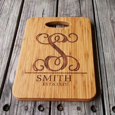 This custom-made bamboo cutting board measures 12.5 tall and 9 wide and can be engraved with the personalization of your choice. A preview of each of the letters in this font can be seen in the listings pictures.  Feel free to put this beauty to use! Just cut on the back and use the front for a sweet display piece in your kitchen. Each piece has been treated with a food-safe conditioner/sealer and arrives ready to use.  Please be sure to include your personalization information in the no...