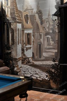 Beautiful 3D wall mural featuring a street in an old European town that visually expands the room space. Hand painted in a billiards room.  #poolroommural #billiardsroommural #gameroommural