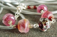 #Lampwork Bracelet//OOAK Bracelet//Gift for by KreationsbyKarenNB Oh lala features our raspberry organic beads =-)