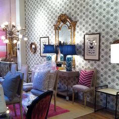 Girly decor explosion at Great Jones Home in Seattle. Young wallpaper plus old(like) Frenchy chairs. Yes.