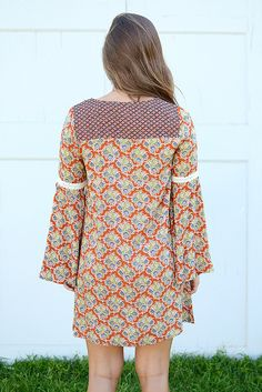 This fall beauty is calling your name! By Flying Tomato, we absolutely love the warm colors featured in this boho dress. It has got that classic shift silhouette we all love and wide bell sleeves! Lac
