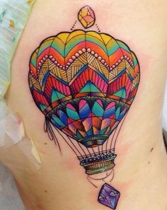 Gorgeous jewel tone hot air balloon tattoo