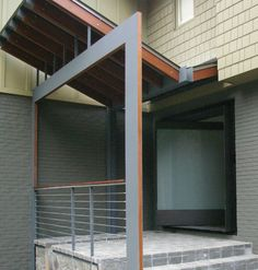 Contemporary charcoal entrance with a 20 39 s art deco for Southern crafted homes inventory