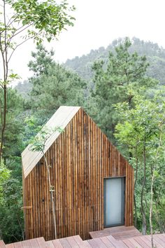 Wooden Spa house between bamboo woods, Garden Valley - Mei Jie Mountain Hotspring resort in Liyang, China. by AchterboschZantman architecten #treehouse #path #bamboo #forest