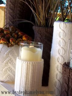 Use sweater sleeves over cheap vases for winter decor...thrift shop stop!...
