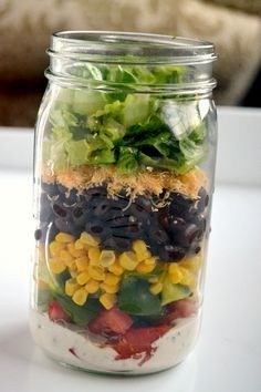 Barbeque Chicken Mason Jar Salads recipe - can be made ahead of time and enjoyed throughout the week! They are filling with BBQ chicken, black beans, corn, cheddar cheese and vegetables.