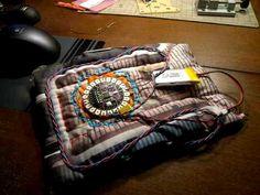 Servo Motor with Lilypad Arduino by IWASAKIOsamu animates electronic textiles. YouTube  (October 2009) #kinetic