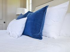 White bed with blue