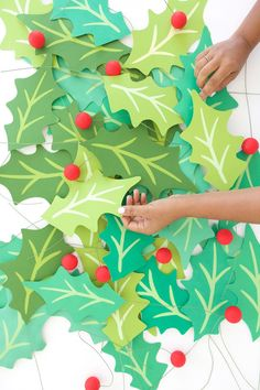 Giant Paper Holly Garland Grab some green cardstock and start crafting! This giant paper holly garla Diy Christmas Lights, Christmas Paper, Outdoor Christmas, All Things Christmas, Christmas Decorations, Christmas Ornaments, Paper Decorations, Office Christmas, Christmas Holidays
