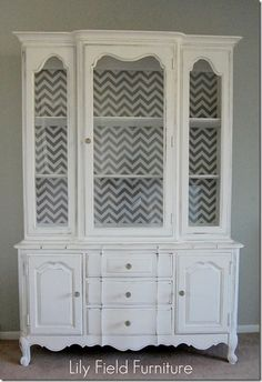 this was an old oak cabinet painted.  Love the back of the cabinet!!!!  I have one of these.  Want to do this