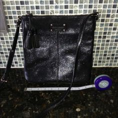 Kate spade leather crossbody bag blk Gently used crossbody bag from kate spade. Color is black with light glitter in the background. The bag does have some minor scuffs that aren't noticeable. kate spade Bags Crossbody Bags