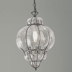"""Fasciati Glass Lantern   Top cap has thumb screw and entire bottom is removed to change bulb. Canopy: 5.25"""" round. Cord: 7' brown. 60 watts medium base bulb. (18""""Hx12.5""""W)."""
