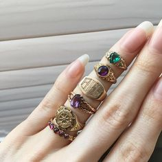 Wednesday #fingerstack 💜❤️💛💚 #forsale #showmeyourrings #etsy #etsyshop #ringsofinstagram #lovegold #stacksonstacks #amethyst #garnet #nautical #1923 #signetring #shipswheel #heartring #bfg #fashion #rings #jewelry #gold #instagood #instadaily #wednesday