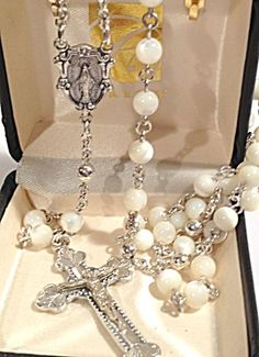 $120 Stunning genuine mother of pearl rosary beads marked Italy Creed. These rosaries come in a gift box with display hooks and are 22 inches long. Perfect gift for a Communion, Confirmation, Christening or Christmas gift.  There is an Our Lady of Grace and Miracles / Virgin Mary of the Miraculous Medal centerpiece and a 2 inch long crucifix.