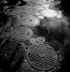 A man in LA dug through scrapyards until he found enough manhole covers to pave his driveway...along with some cobblestones and bricks. Stunning!!