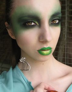 Mean green fairy make-up.  That absinthe packs a punch.  ;)