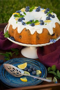 This Lemon Blueberry Bundt Cake is topped with the most amazing lemon cream cheese icing. The cake is dense, almost like a pound cake, but it's super moist and irresistible. This is the perfect summer cake! Lemon Cream Cheese Icing, Lemon Icing, Cake With Cream Cheese, Kinds Of Desserts, Lemon Desserts, Just Desserts, Dessert Recipes, Cake Cookies, Cupcake Cakes