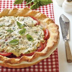 Tomato Pie | Tomato pie is a Southern favorite. Pair tomatoes and fresh herbs with a flaky sour cream pastry crust and you won't be able to resist this dish! | Classic Southern #Recipes | SouthernLiving.com