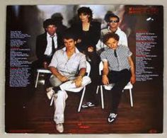 Crimes of Passion - album backside. Neil Giraldo so handsome! Pat so beautiful in this picture! Myron so...akwardly cute & strange! Note the sunglasses broach on Pat's lapel. I finally found close replica in London years later. Still have it!  My FAVORITE Pat Benatar record.  Released 1980