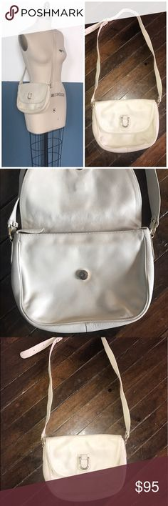 """vintage COURREGES PARIS cross-body shoulder bag small satchel / cross body purse from legendary designer  color is ivory / bone / beige / off white 🖤 inside: beige lining, three sections with two zipper pouches - great for staying organized - embossed """"made in france"""" 🖤 some signs of age - patina on the leather & hardware, a bit of yellowing at the creases of the leather. still very soft and in great shape. magnetic closure is working, and bag has no internal stains 🖤  size:  10.5"""" wide…"""