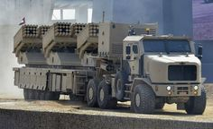 "A very recent purchase by the United Arab Emirates, the Jobaria Defense System Multiple Cradle Launcher System. Armed with 240 tubes of 102mm and 122mm, this mobile artillery system does the job of 6 older rocket artillery vehicles. A support vehicle is available to travel with and resupply the JDS if all of its 240 rockets are fired.  Each JDS comes with an Oshkosh armored 6x6 HET (Heavy Equipment Transport). Jobaria supposedly means ""Monster""."