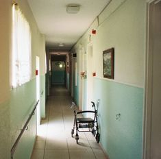 Hostility #film #35mm #expired #kodak #grain #analogue #southafrica #exploration #zen #Ishootfilm #buyfilmnotmegapixels #melancholy #wheelchair #hall #natural #painting #oldage #tiles #handrail #escape