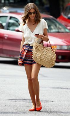 Olivia Palermo In A White Top And Bright Shorts