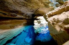 Enchanted Well at Chapada Diamantina in Bahia, Brazil. Located at Chapada Diamantina National Park, this well's water is 120 feet deep and is clear enough to see the rocks. (27 Surreal Places to Visit Before You Die)