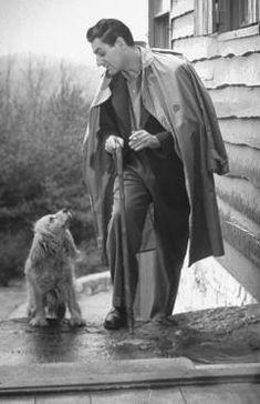 Gian Carlo Menotti walking his dog in the rain.