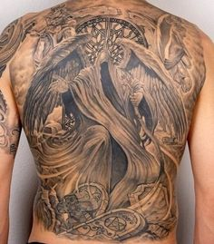 A full back Grim Reaper tattoo. Beautiful and well detailed at the same time. The reaper dons angel wings as it hides its face in the abyss as it is accompanied by two angel-like beings at the back.