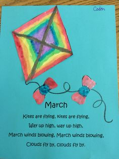 We made these mini watercolor  kites for our March memory book page.