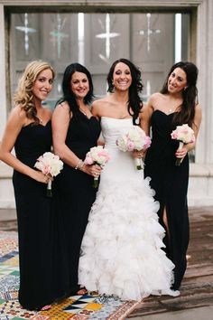 Chic, long black bridesmaid dresses with soft pink and white bouquets