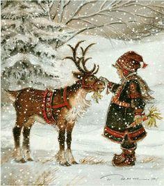 Girl feeding reindeer before the big flight of Christmas Eve.