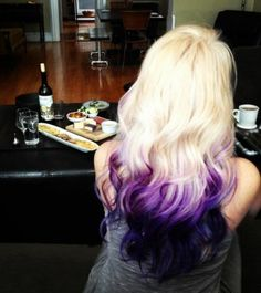 Platinum and purple ombre hair.