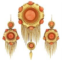 A mid-Victorian coral fringe suite  A mid-Victorian coral fringe suite, the suite comprising bangle, necklace, brooch and earrings, all set with coral beads in a cluster design within a yellow gold rope design border, with coral bead surround in a yellow gold mount with floral motif decoration, gross weight 81.5 grams, circa 1860.