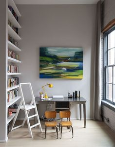 """Workspace inside a family loft in Brooklyn. """" An alcove opposite the dining area has been cleverly put to use as a library, thanks to an extended kitchen wall and shelves added by Robertson and..."""
