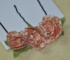 Beautiful paper roses attached to bobby pins w/wire wrapping