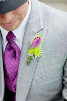 Purple tulip boutonniere for groomsmen.   radiant orchid wedding inspiration