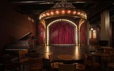 """""""Speak easy with proscenium-style stage 1922 Lyon & Healy baby grand piano, beautiful reassembled and restored vintage bar. Entertainment includes Cabaret, Burlesque, Comedy, Magic, Vaudeville, Variety, Swing Dance, Jazz & Blues, etc. If it was a popular form of entertainment between 1920-1960, chances are it will be on one of our stages."""""""