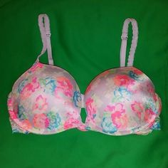 Victoria's Secret Pink Push Up Padded Bra 36D Cute floral print push up & padded bra from VS Pink. Lace sides and back which I believe make it fit slightly looser than a regular 36d... I bought it on posh but it's a bit too big for me.  It has adjustable /multi-way straps. I never wore it and it looks like it's hardly been worn. Happy to bundle and take offers! PINK Victoria's Secret Intimates & Sleepwear Bras