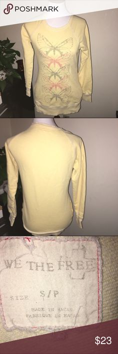 {Anthropologie} Free People sweatshirt w/ pockets! This is a very cute distressed look sweatshirt. It has pockets too. Features a cute butterfly motif. Perfect for lounging. Does have a tiny mark near the shoulder as pictured in the 4th pic. Otherwise it's in great condition. Price reflects condition. Anthropologie Tops Sweatshirts & Hoodies