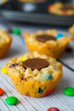 Peanut Butter Cup Stuffed Monster Cookie Cups are a fun and easy dessert recipes. The oatmeal peanut butter cookies are loaded with mini M&Ms and each cookie cup has one mini Reese's peanut butter cup pressed into the center. Peanut Butter Desserts, Peanut Butter Oatmeal, Peanut Butter Cups, Cookie Desserts, Easy Desserts, Cookie Recipes, Delicious Desserts, Yummy Food, Butter Rice